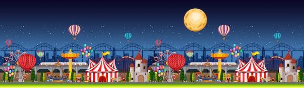 Escena del parque de atracciones en la noche con globos y panorama lunar