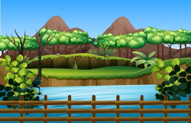 Escena del parque con estanque y árboles
