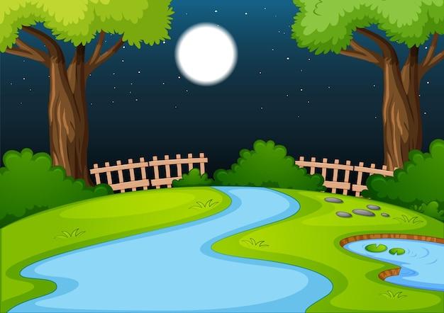 Escena del parque vacío con muchos árboles y río por la noche