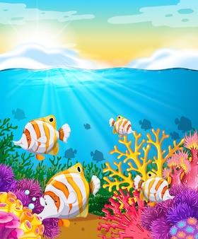 Escena con peces bajo el mar