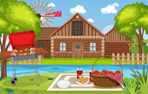 Escena de picnic con comida en la mesa y parrilla en el jardín