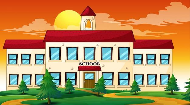 Escena de la puesta del sol del edificio escolar