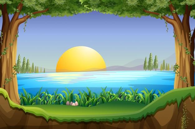 Escena con puesta de sol en el lago