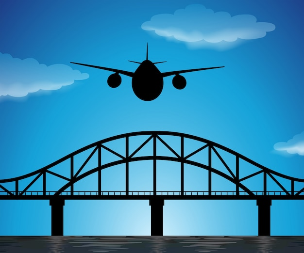 Escena de silueta con avión volando en el cielo azul