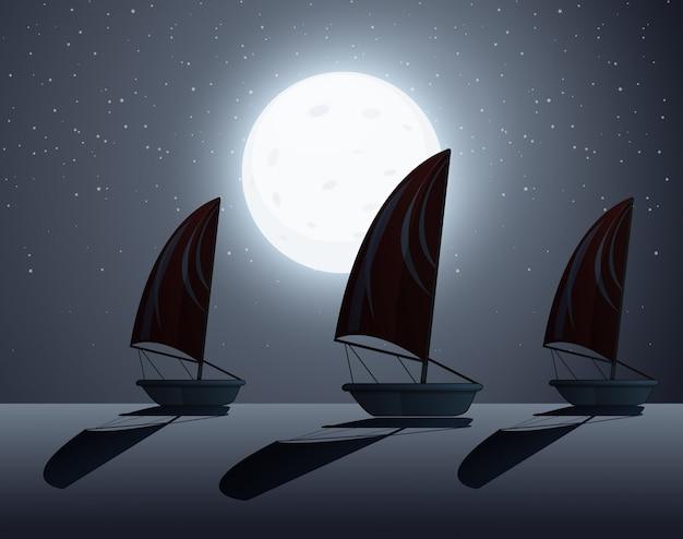 Escena de silueta con veleros por la noche