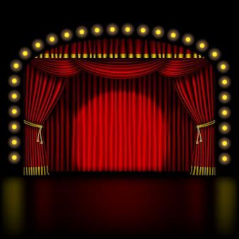 Escenario con cortina roja y luces.