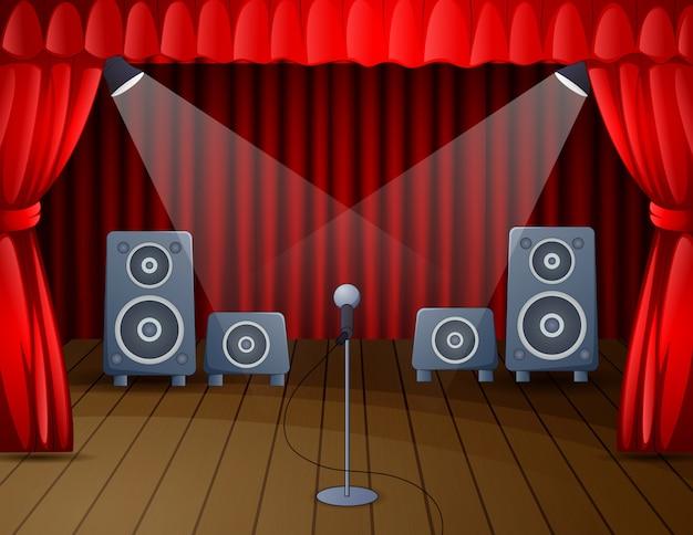 Escenario festivo con micrófono y altavoz.