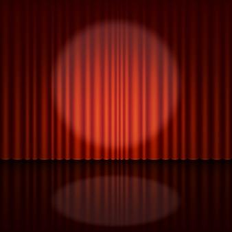 Escenario con foco y cortina roja.