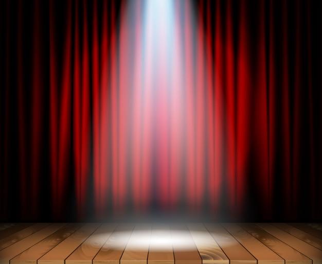 Escenario de teatro con piso de madera.