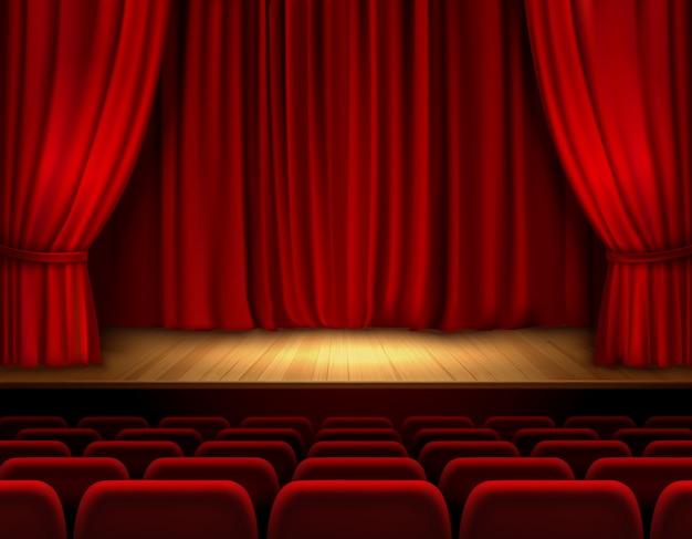 Escenario de teatro con terciopelo rojo abierto.