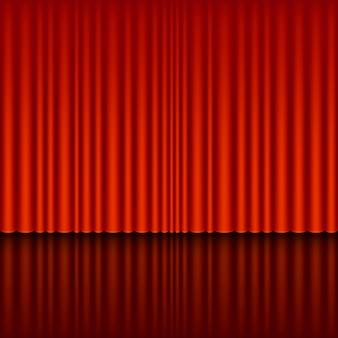 Escenario con telón rojo.