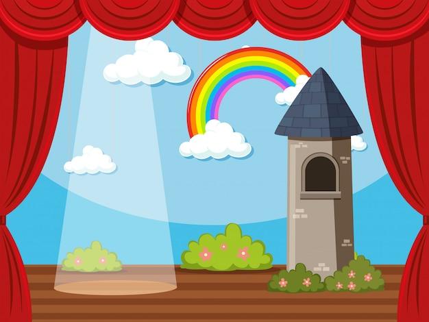 Escenario con torre y arcoiris.