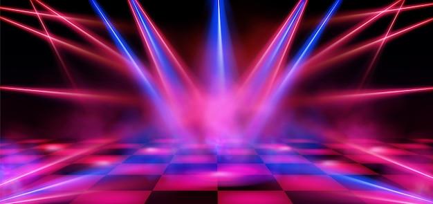 Escenario vacío del club nocturno iluminado con focos rojos y azules.
