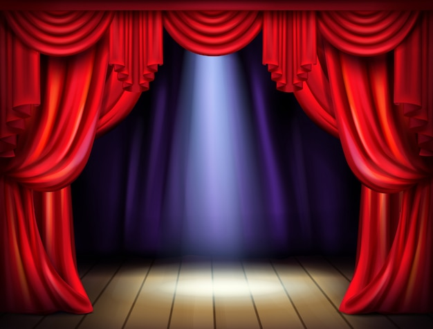 Escenario vacío con cortinas rojas abiertas y haz de luz del proyector en el piso de madera