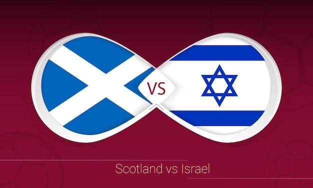 Escocia vs israel en la competición de fútbol, grupo f. versus icono sobre fondo de fútbol.