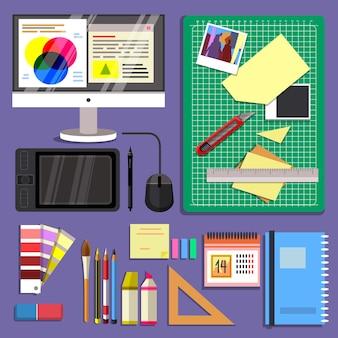 Escritorio de diseño gráfico con diferentes objetos.