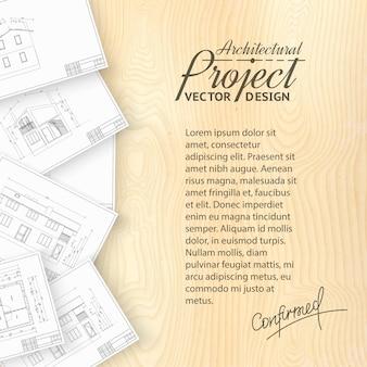 Escritorio de madera con bluerints de arquitectura