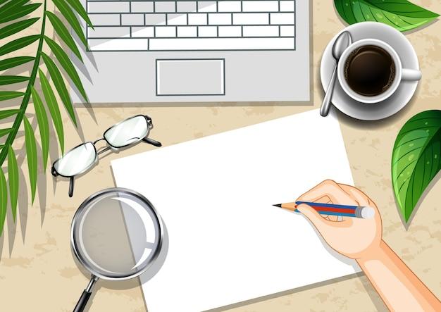 Escritorio de oficina de vista superior con elementos de oficina con hojas verdes