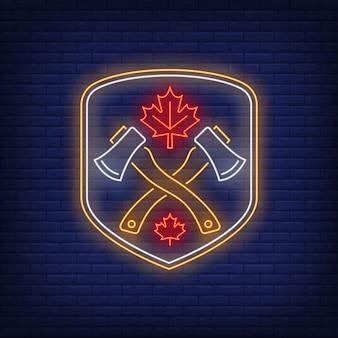 Escudo con ejes cruzados y letrero de neón de hoja de arce