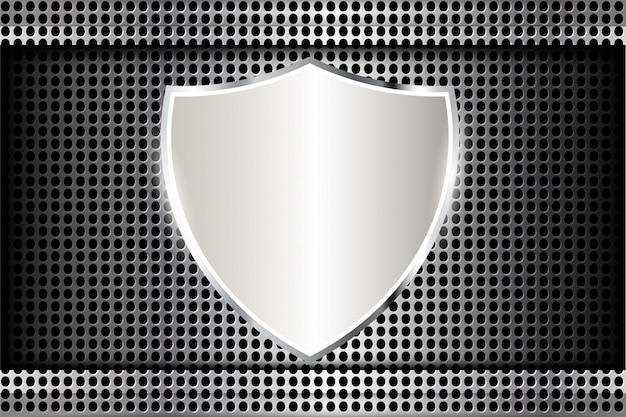 Escudo de metal en textura perforada.