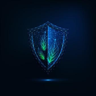 Escudo poligonal bajo brillante futurista con hojas verdes sobre azul oscuro