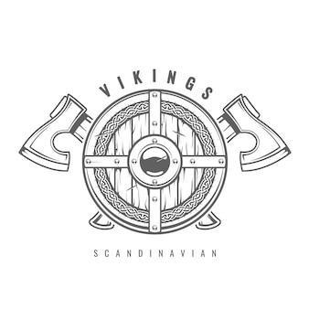 Escudo vikingo redondo con hachas cruzadas y patrón celta