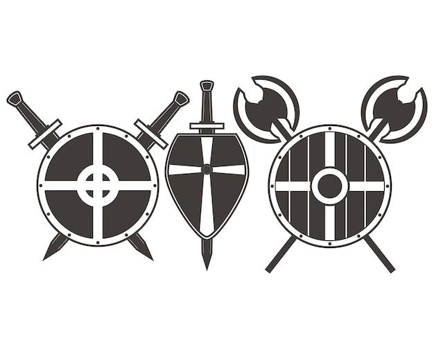 Escudos medievales y hachas de espada