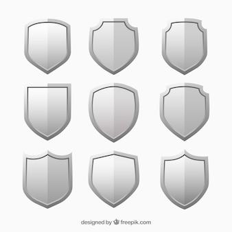 Escudos metálicos fijados