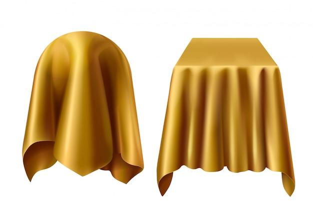 Esfera y caja cubiertas con tela dorada.