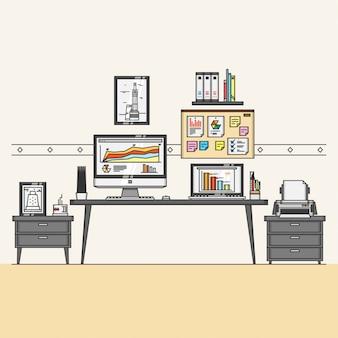 Espacio de trabajo interior con elemento de oficina.