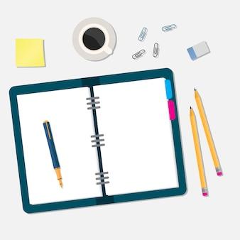 Espacio de trabajo de oficina con libro abierto y objetos.