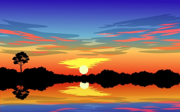 Espectacular escena del atardecer en el lago con nubes