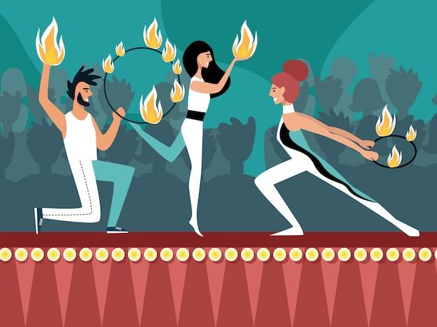 Espectáculo de fuego en el escenario con hombres y mujeres gimnastas