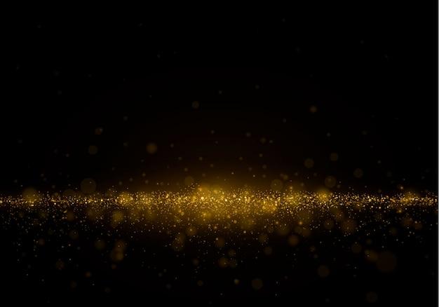 Espumoso polvo mágico y partículas doradas sobre fondo negro.