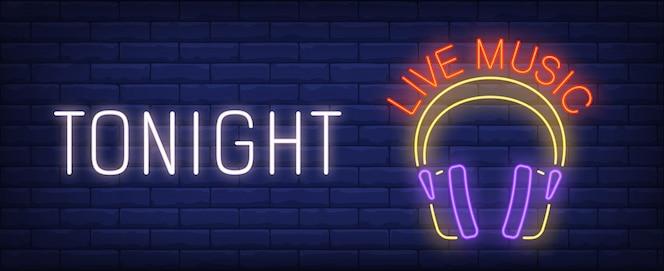 Esta noche, música en vivo, letrero de neón. auriculares brillantes de dj en la pared de ladrillo.