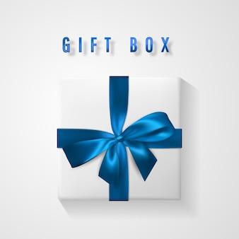 Establecer caja de regalo blanca con lazo azul y vista superior de la cinta