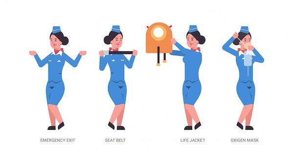 Establecer la guía de la azafata explicando las instrucciones con el chaleco salvavidas, la salida de emergencia del cinturón de seguridad y la azafata con máscara de oxígeno en un concepto de demostración de seguridad uniforme de longitud completa