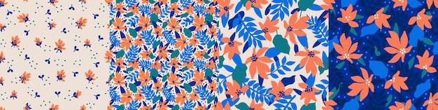 Establecer patrones sin costuras de moda con flores decorativas dibujadas a mano en tonos azul y coral patrones de vectores florales para la fabricación de papel de regalo con estampado textil