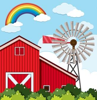 Establo rojo y turbina de viento en la granja