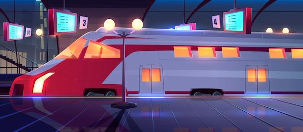 Estación de tren con tren de alta velocidad en la noche
