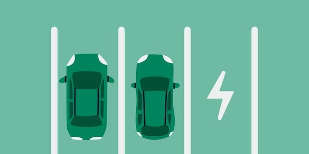 Estacionamiento de automóviles eléctricos dos automóviles ecológicos en el lugar de estacionamiento para cargar una vista superior