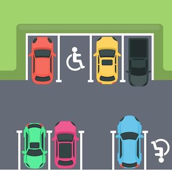 Estacionamiento vista superior. autos y espacios para discapacitados.