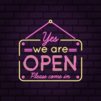 Estamos abiertos, ven en luces de neón rosa