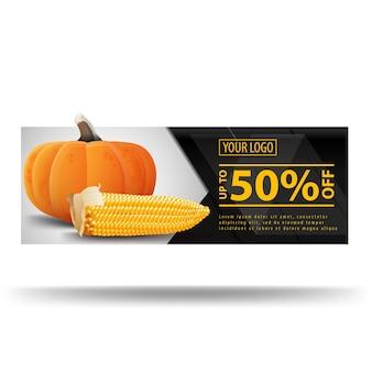 Estandarte oscuro con calabaza y espiga de maíz.