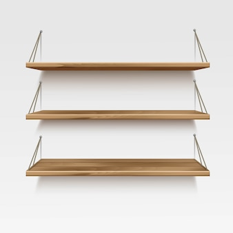 Estantes de madera vacíos estantes sobre fondo de pared