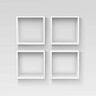 Estantes vacíos blancos estantes aislados sobre fondo de pared