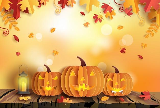 Estilo de arte de papel de calabazas sobre fondo de madera de otoño