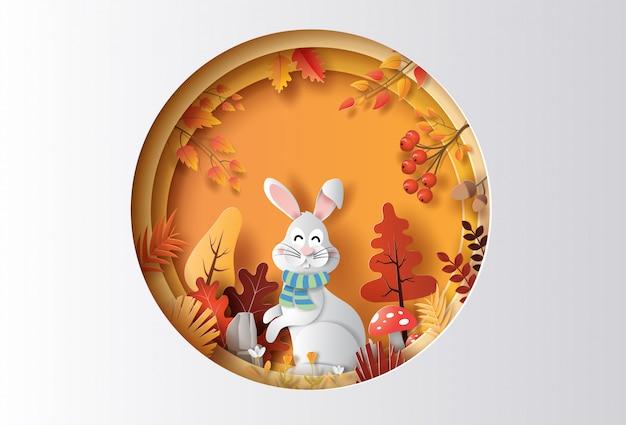 Estilo de arte de papel de fondo otoñal con conejo en un bosque, muchas flores y hojas hermosas.