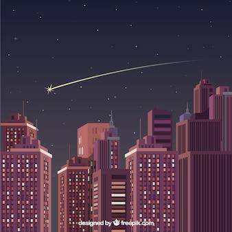 Estrella fugaz sobre una ciudad grande de noche