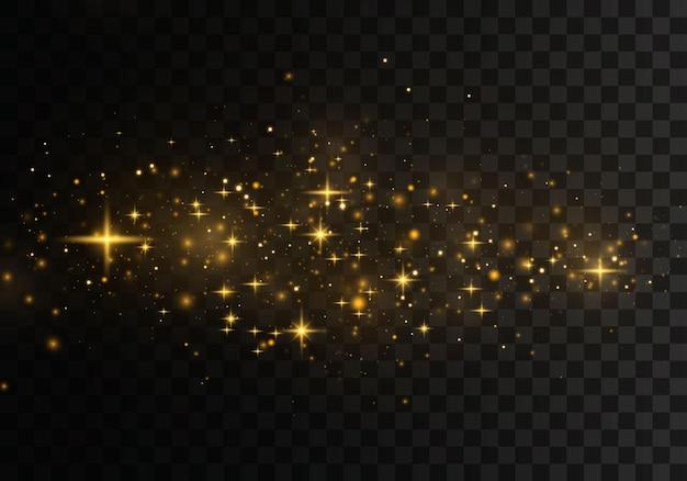 Las estrellas doradas brillan con una luz especial. partículas de polvo mágicas brillantes.